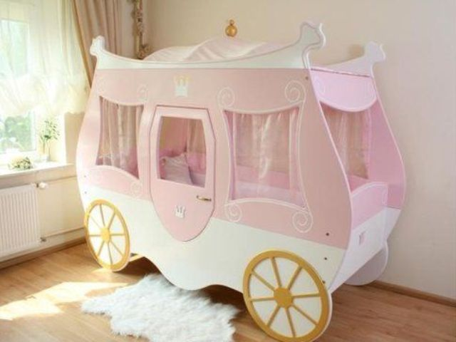 cute pink carriage bed with gold wheels