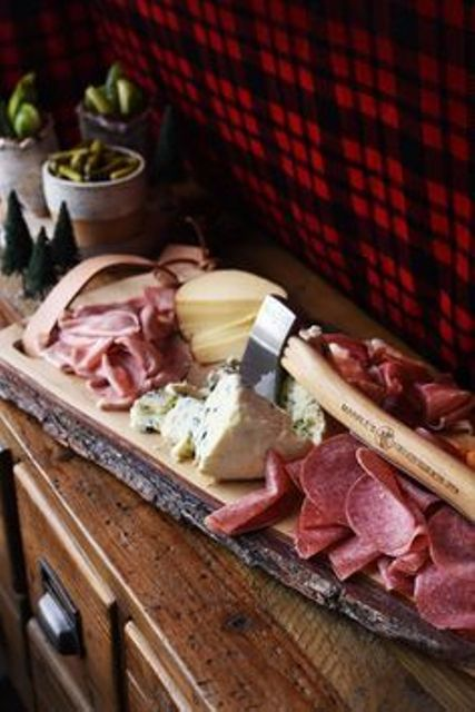 meat and cheese board piled high is a must for a lumberjack party