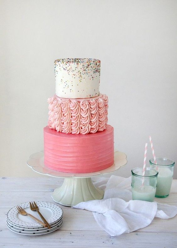 pink cake with different layers - ruffled, plain and colorful one