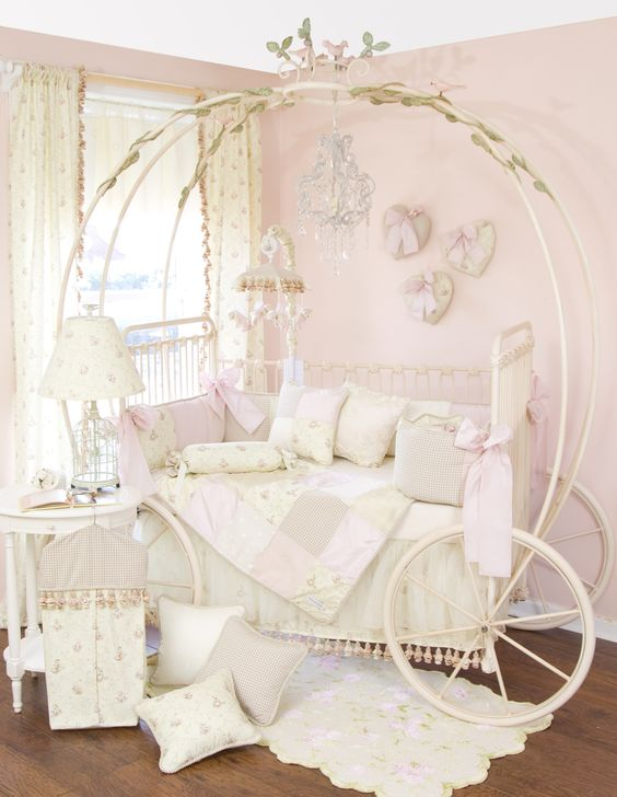 sophisticated Cinderella carriage bed with off-white and blush decor