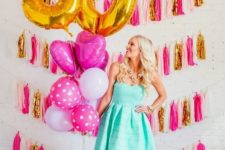 16 glam colorful tassel wall and lots of balloons