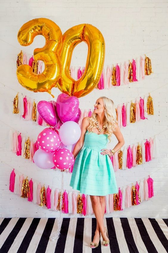 glam colorful tassel wall and lots of balloons
