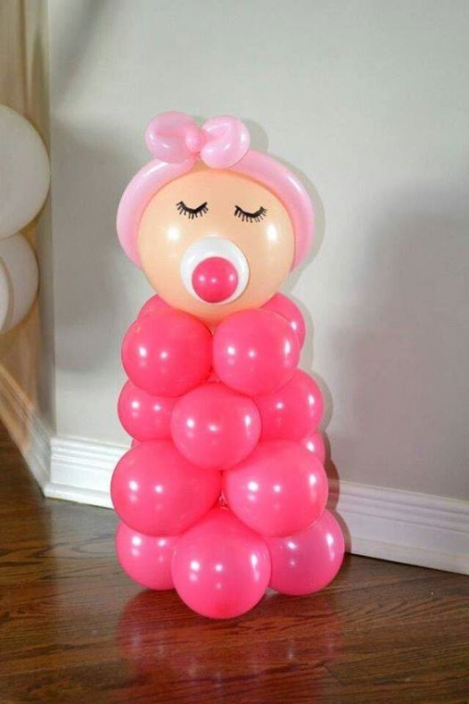 baby made of balloons, pink for a girl's party and blue for a boy's one