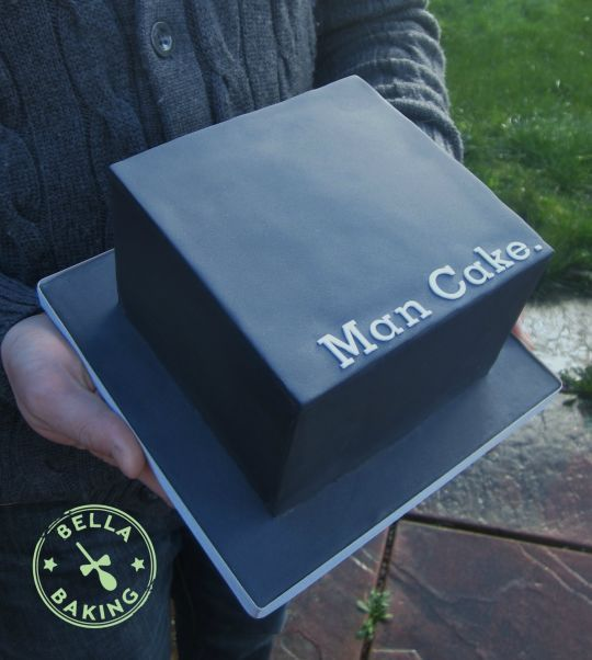 black square man cake with no other decor looks brutal