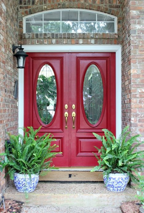 bold red doors and blue and white porcelain planters with fern for low maintenance
