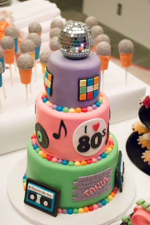 colorful 80th birthday party cake with a disco ball
