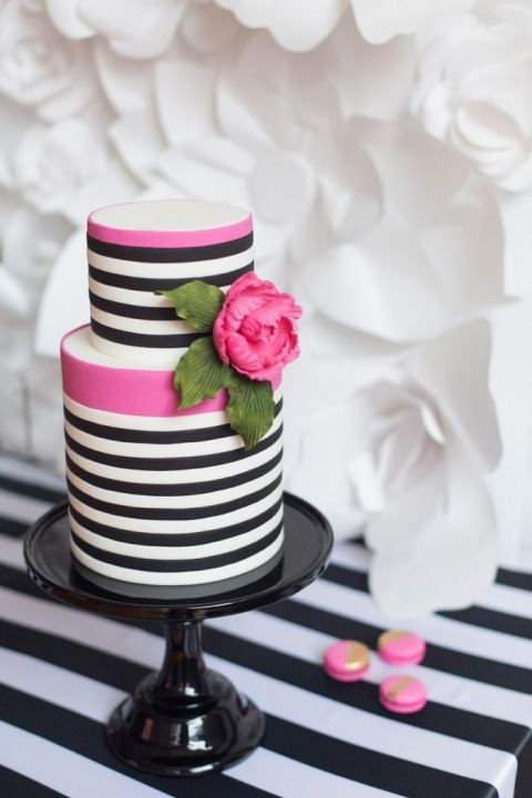 pretty black and white striped wedding cake with hot pink decor