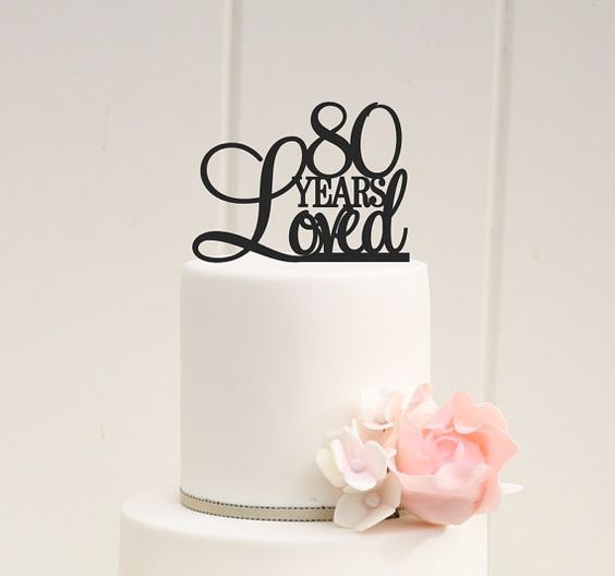 elegant 80th birthday cake with a cool topper