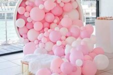 18 pink and white balloons falling from a large cup