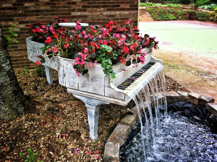 an old piano repurposed into a garden bed and a