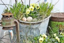 19 rustic metal buckets and planters for holding your spring arrangements