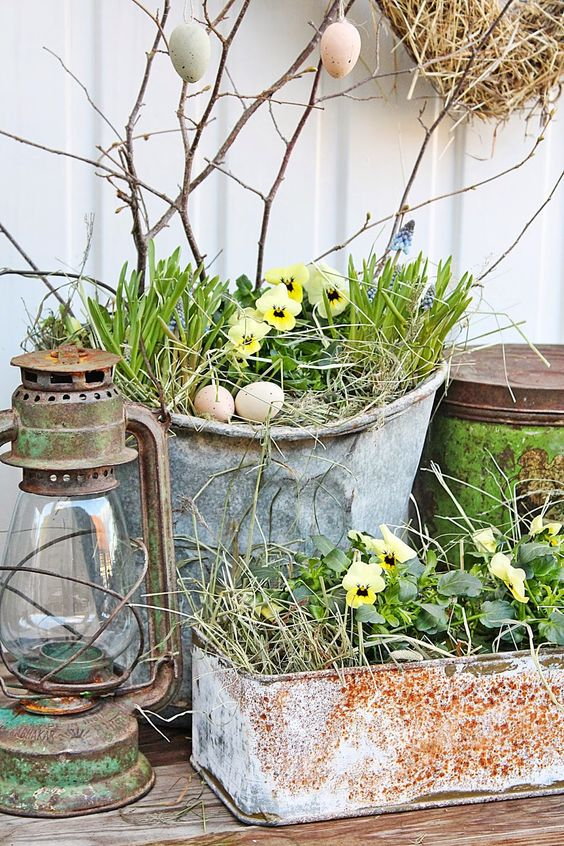 rustic metal buckets and planters for holding your spring arrangements