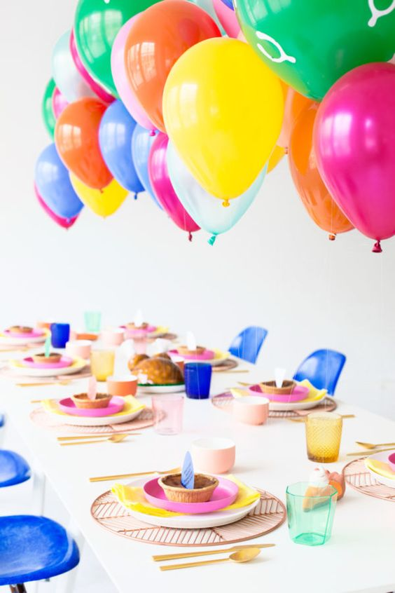 colorful balloons over the reception table will excite the kids
