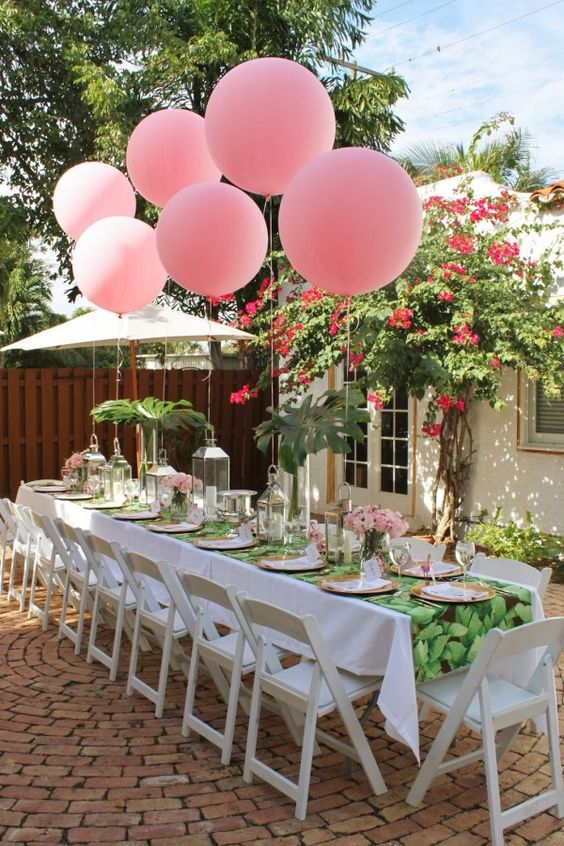 pink balloons attached right to the table for decor