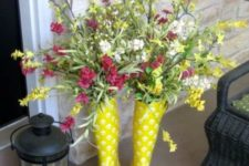 20 sunny yellow boots with fresh flowers and a candle lantern