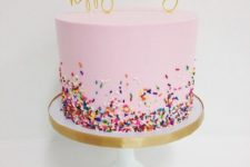 21 pink, sprinkles and a gold cake topper