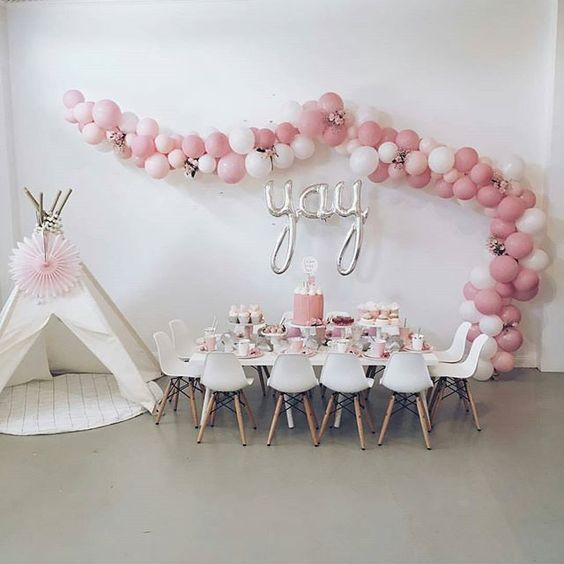 white and pink balloon garland over the reception