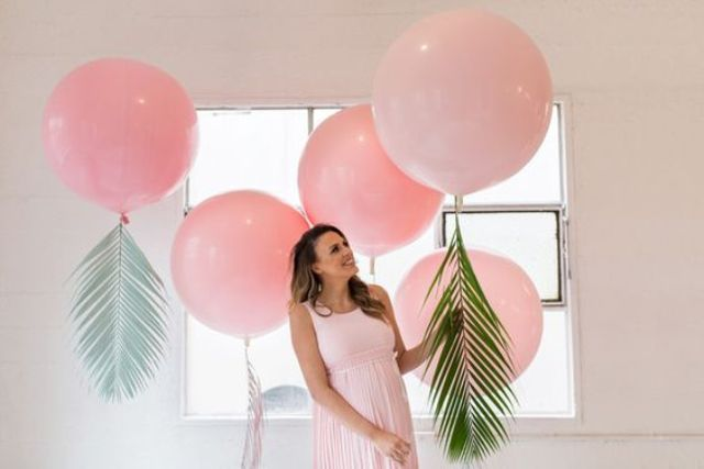 pink balloons with tropical laves for a girl's tropical baby shower