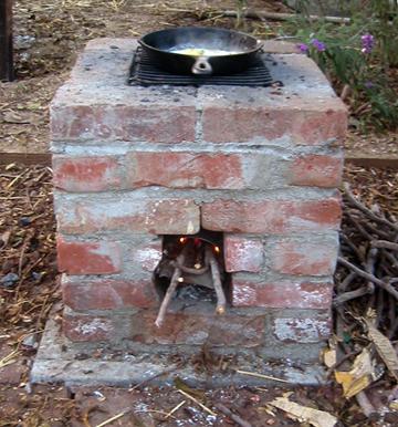 DIY outdoor brick rocket stove (via www.rootsimple.com)