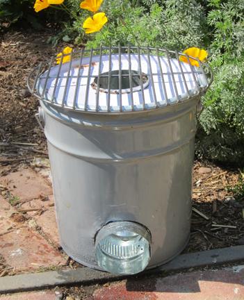 DIY rocket stove of a 5 gallon metal bucket (via www.rootsimple.com)
