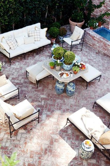 aged brick laid in herringbone pattern for a chic look and modern ivory-colored furniture