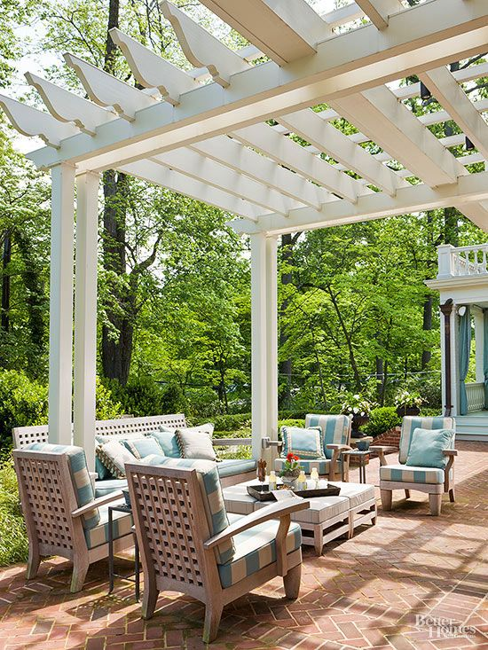 bricks arranged in herringbone patterns fashion patios that enhance traditional and historic homes and gardens