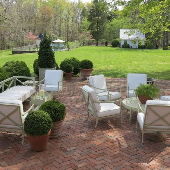chic herringbone brick patio with contrasting white furniture for a cool look