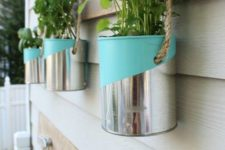 collect aluminum cans, add an interesting color graphic, and hang along an exterior wall or porch beam