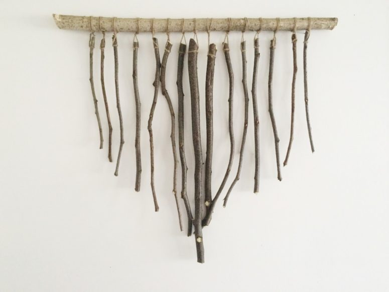 DIY branch wall hanging for rustic spaces (via www.averystreetdesign.com)