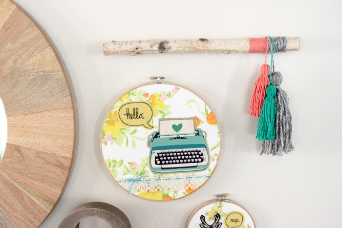 DIY twig wall decor with colorful tassels (via www.petitepartystudio.com)
