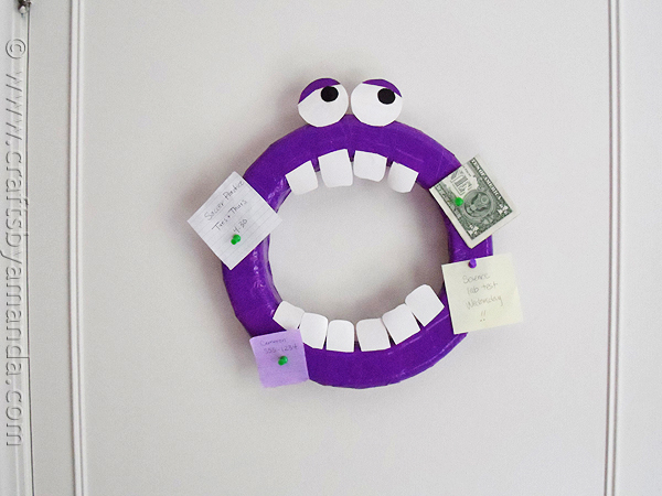 DIY monster corkboard of a wreath and duct tape (via craftsbyamanda.com)