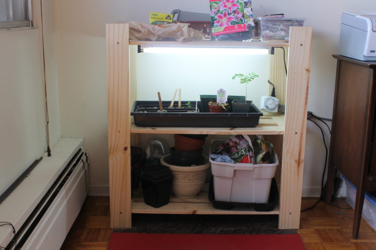 DIY indoor greenhouse station with lights (via www.thebohemiankitchen.net)