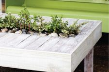 DIY whitewashed rustic cocktail table with greenery