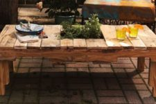 DIY rustic pallet table with a herb garden