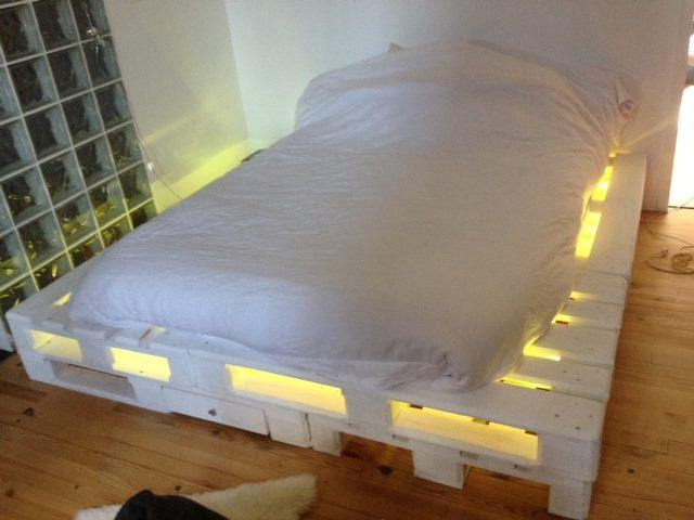 DIY pallet bed with lights and drawers (via www.99pallets.com)