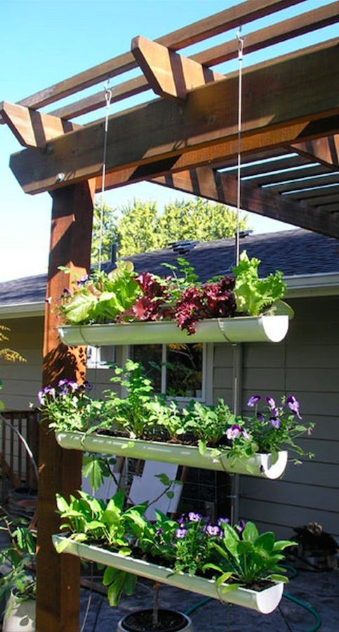 hanging gutter garden for your outdoor space is a simple DIY idea