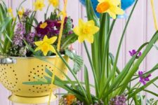 put old kitchen colanders to good use and transform them into pretty hanging baskets for plants