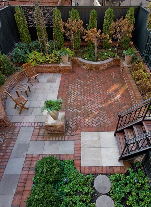 this awesome brick and stone patio makes incredible use of a small, enclosed yard space