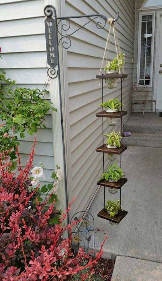 vertical hanging planter on wooden boards