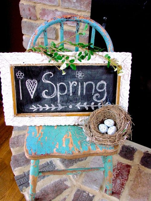a birdie nest with speckled eggs and a chalkboard Easter sign