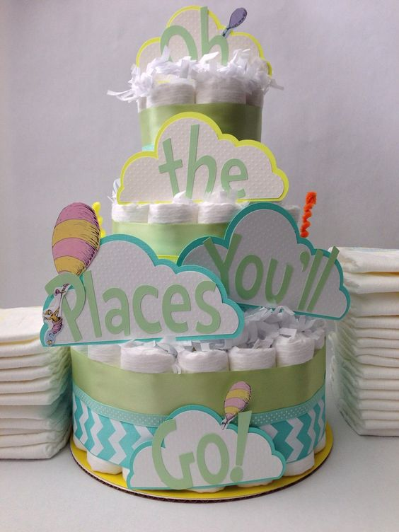 a diaper cake with letter props looks cute