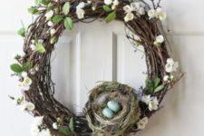 02 a grapevine wreath with faux spring blooms, leaves and a nest