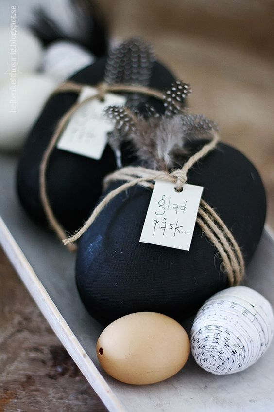 black and feather egg decor with twine