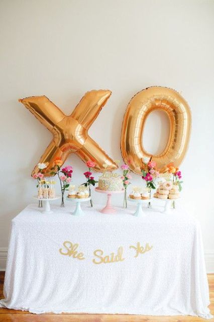 gold letter XO balloons as a dessert table backdrop
