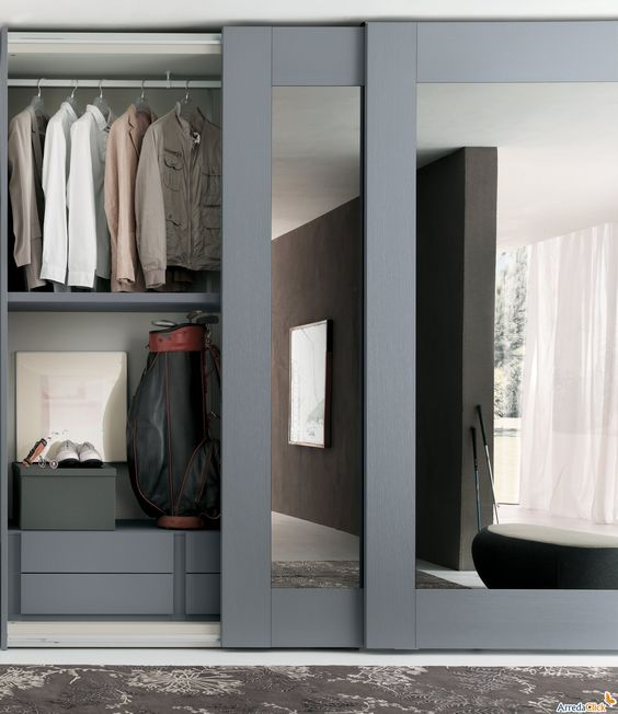 whole wall sliding closet doors with grey frames for a masculine well-organized closet space
