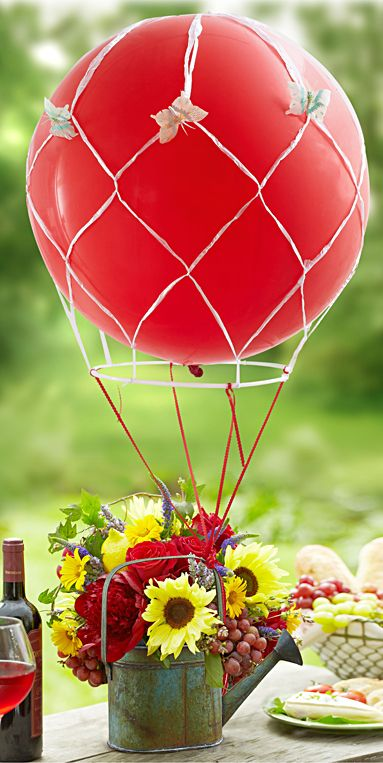 a bold red hot air balloon centerpiece with florals