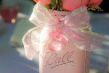 03 a pink mason jar with a ribbon bow and pink and peachy roses