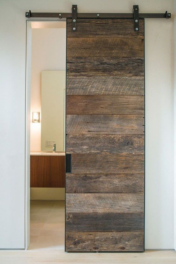 A Reclaimed Barn Door Looks Like A Statement In A Modern Space