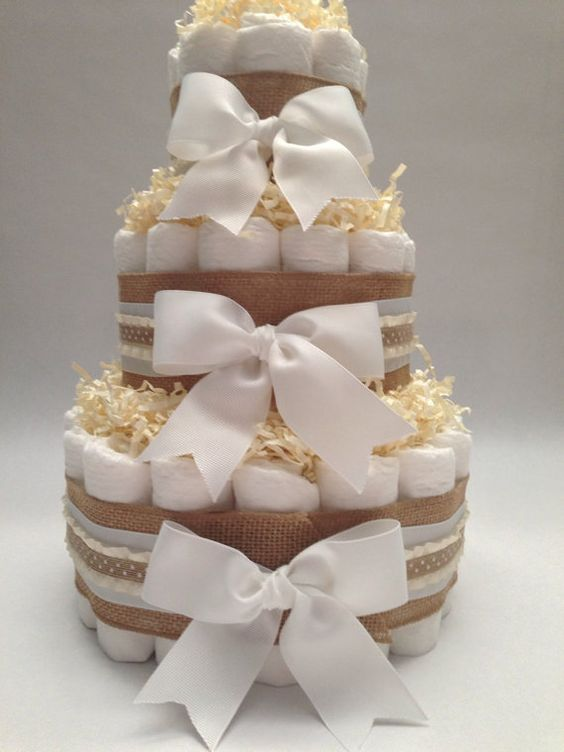 a simple rustic nappies cake with burlap ribbon and bows