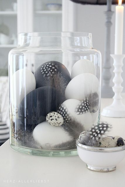 black and white feather egg display in jars